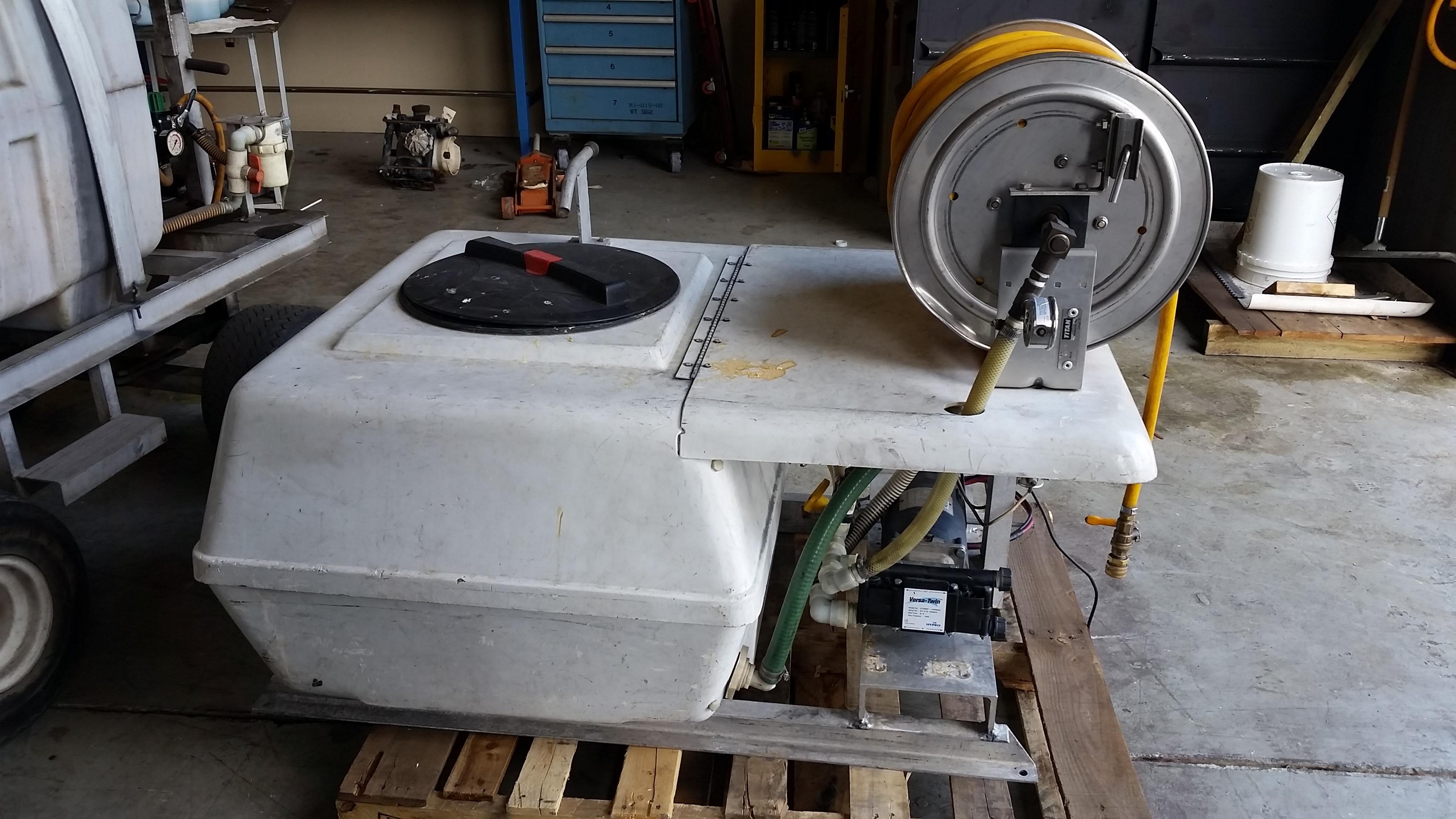 Modified skid sprayer waiting for maintenance.jpg