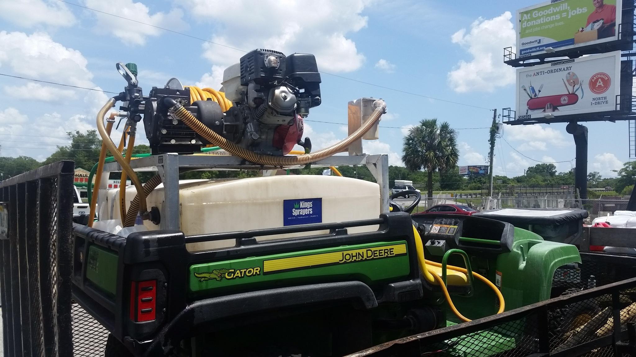 John Deere Gator with a mounted skid sprayer.jpg