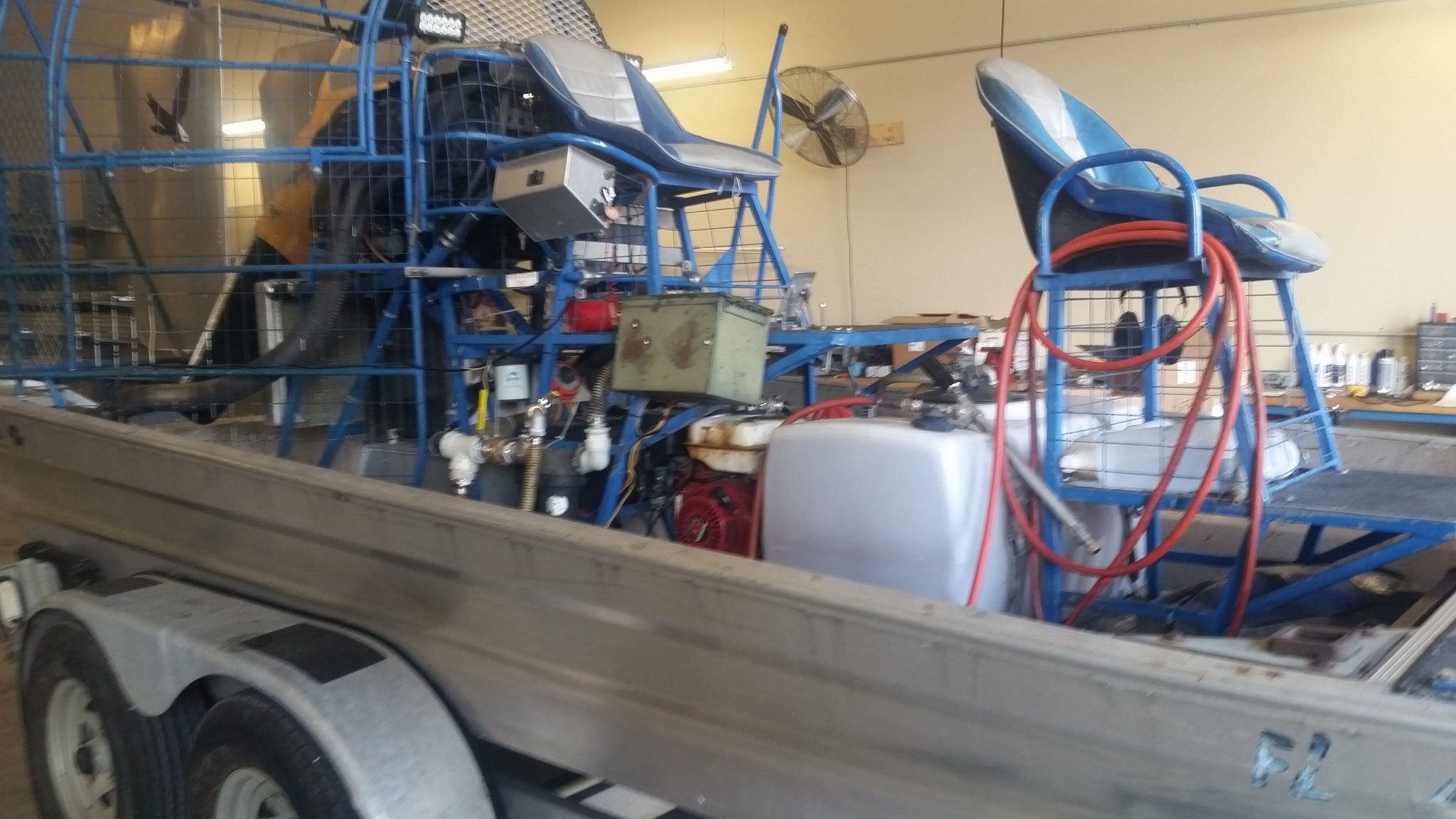 Custom built sprayer mounted on an Airboat