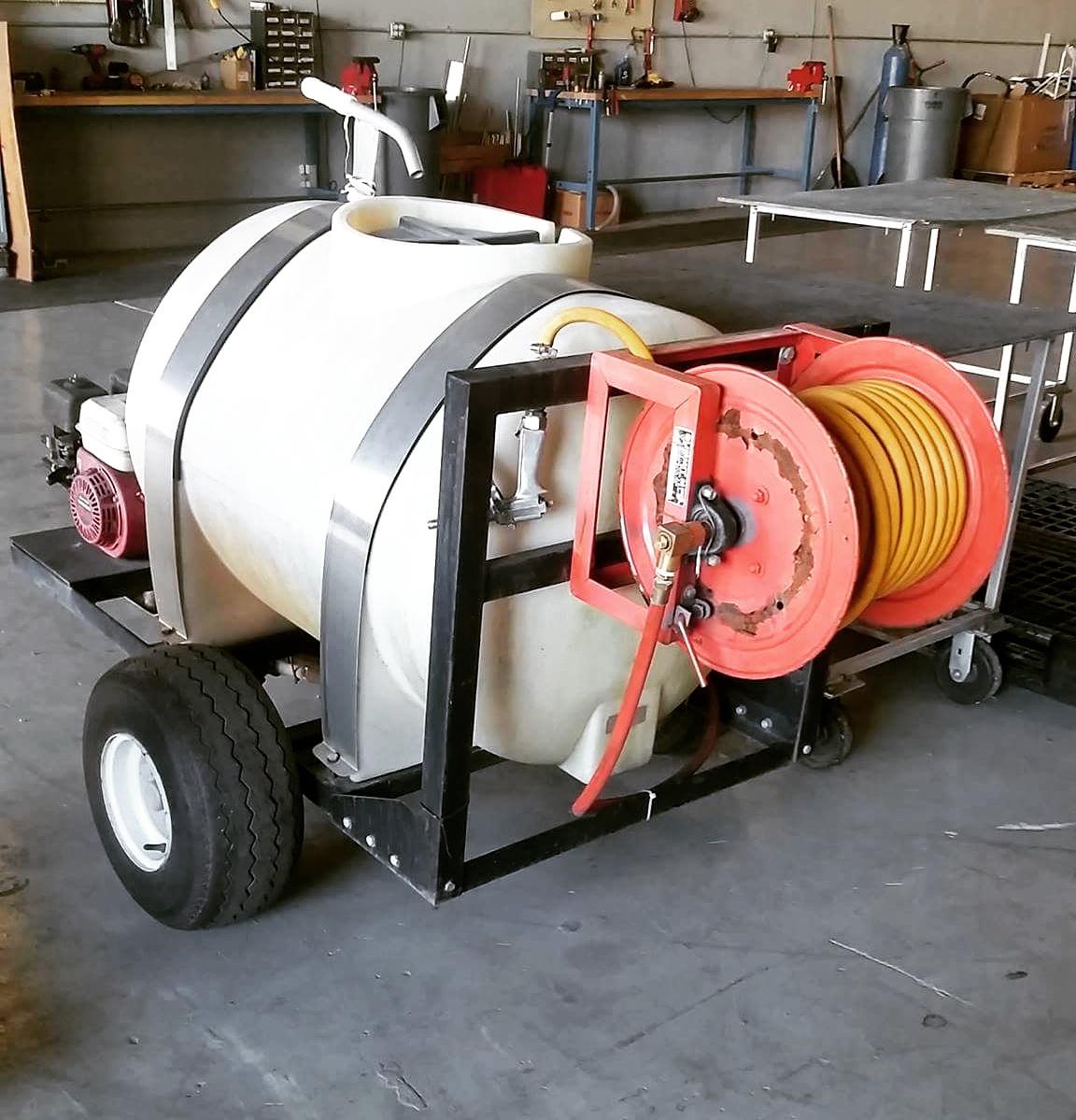 2-wheel sprayer awaiting hose reel repair.jpg