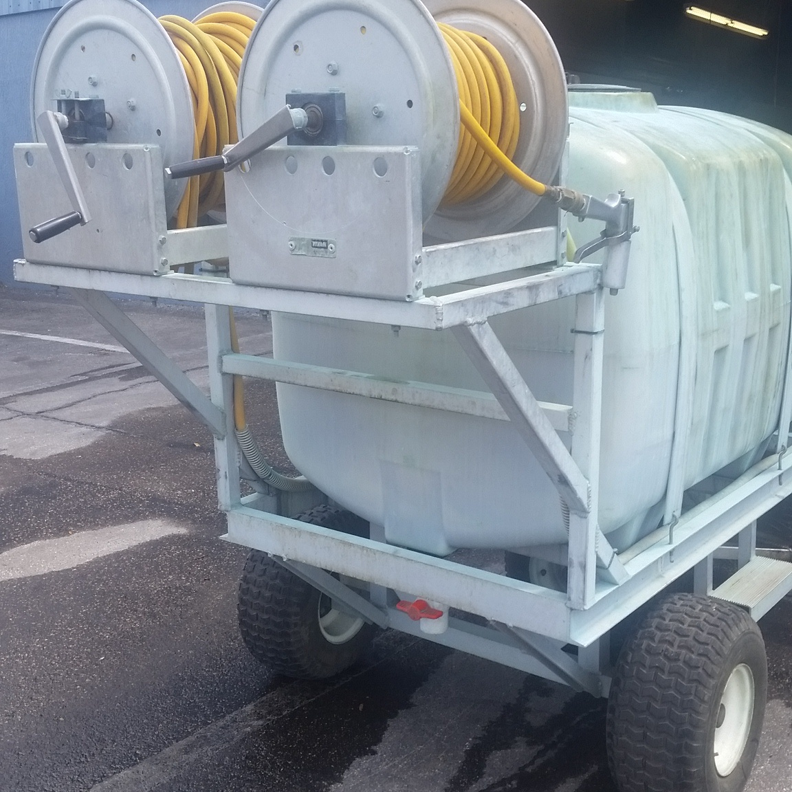 4-wheel sprayer with dual hose reels.jpg